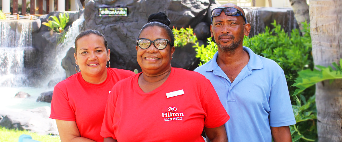 happy-smiles-Challenge-international-Aruba-The-Hilton Caribbean-Resort-VisitAruba-Visit-CaribMedia-Marketing-Employees-Guests-Customer-Service-One-Happy-Island-Hospitality.png